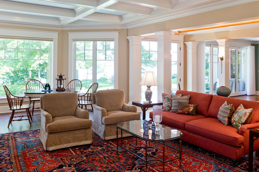 Fawn colored velvet on a pair of swivel chairs provides a soft visual transition from the primary seating zone to the smaller dining and gaming area. Photo: Matthew Lofton