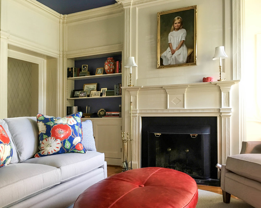 library-mantle-fireplace-bold-room-crown-molding-ottoman-interior-design-home-virginia
