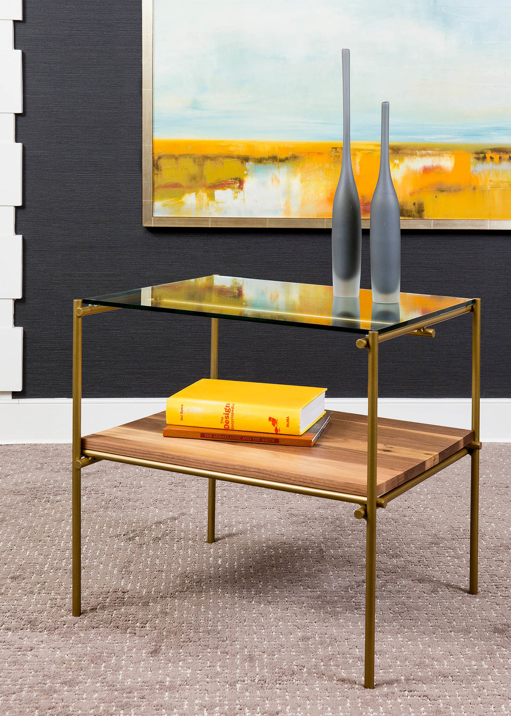 """It is not enough for a side table to be only functional. The silhouette and materials should add a spark of interest to your home. Our Katie table combines burnished gold, glass, and natural walnut to embody a modern, organic elegance."" - Paul Miller, Lookbook 2019"