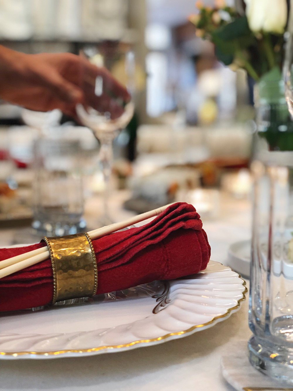 How to roll a napkin for an easy dinner party. Order in for an easy no stress way to have people over for dinner to enjoy your fancy china.