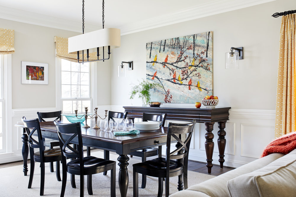 """The designer opened up the ground floor, removing a wall separating the kitchen from the dining/living room to create an L-shaped space. """"The open floor plan was huge,"""" he recounts. """"They wanted all the spaces to feel useful and connected."""" He retained a traditional look but freshened things up with a relaxed vibe and happy colors. And he took the remodeled kitchen in a more streamlined direction. Paul Miller published in Home & Design Magazine. Photo by Stacy Zarin Goldberg."""