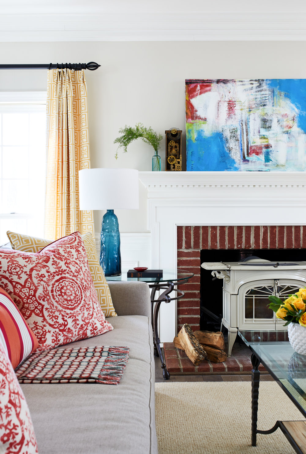 Colonial country house modern remodel. Fireplace with white enamel wood stove. Young family custom designed home. Functional, beautiful, and sustainable. Photo by Stacy Zarin Goldberg