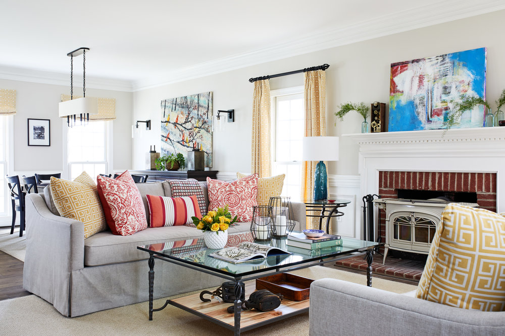 Eclectic transitional style in a traditional colonial country home. Beautiful custom American made furniture. Gray modern slipcovered couches. Vintage collection. Family style with young children. Open floor plan farmhouse remodel. Photo by Stacy Zarin Goldberg.