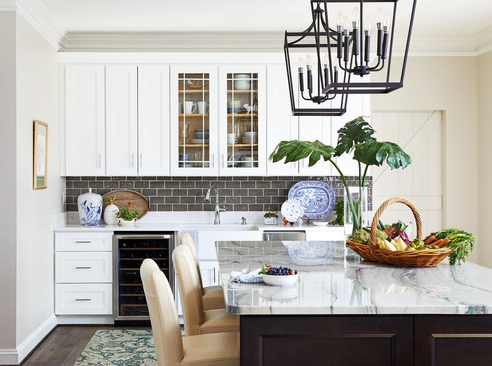Fresh modern farmhouse country kitchen renovation. Gray and white kitchen. Best tile for a backsplash. Vintage inspired floor mats make in America by Spicher & Co. Vintage basket. Marble countertops. Photo by Stacy Zarin Goldberg.