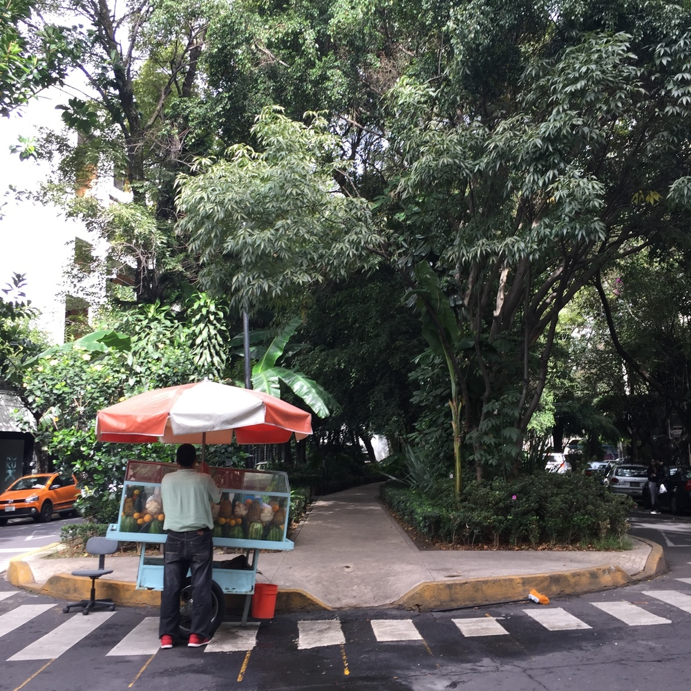 Fruit vendor setting up on the street