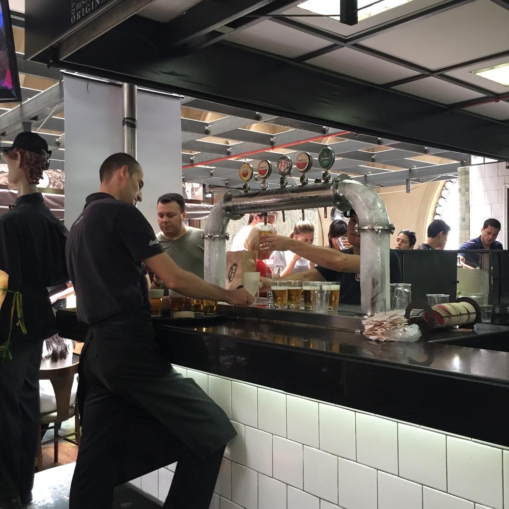 People getting drunk, eating mortadella