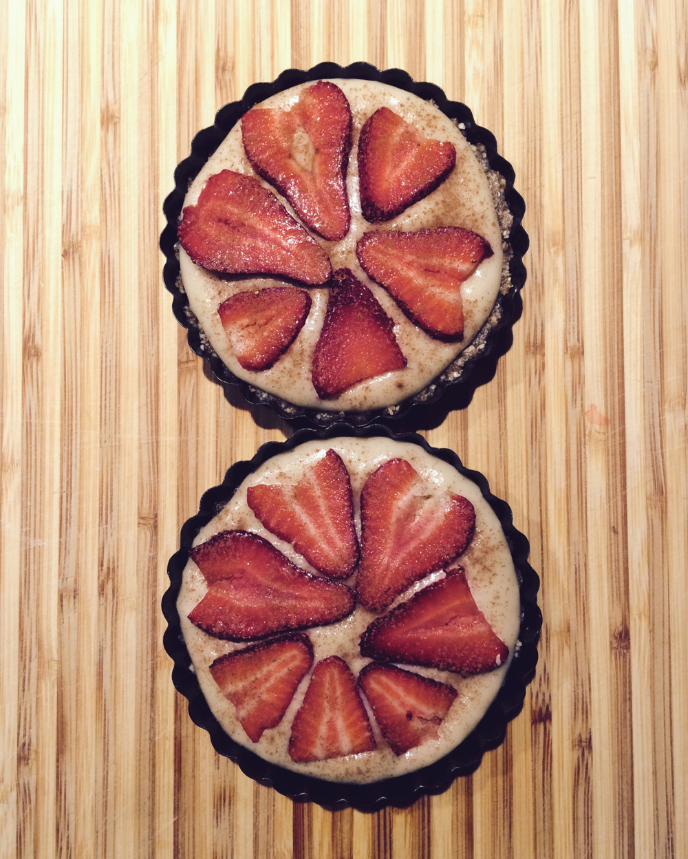 meyer lemon tartlets with brazil nut crust and fresh strawberries