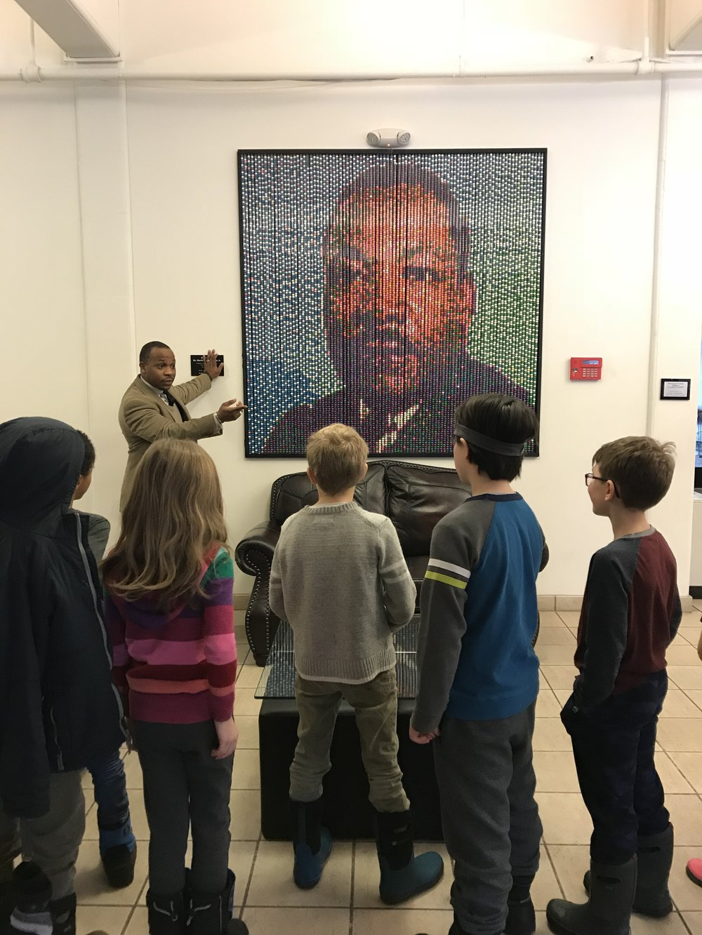 Jevon Collins, Performing Arts Director, directed back-to-back tours for our groups (Chickadees and Cardinals 1, then Cardinals 2 and Hawks). Not surprisingly, this portrait of Dr. King, made of gum balls by community participants, captivated the kids.
