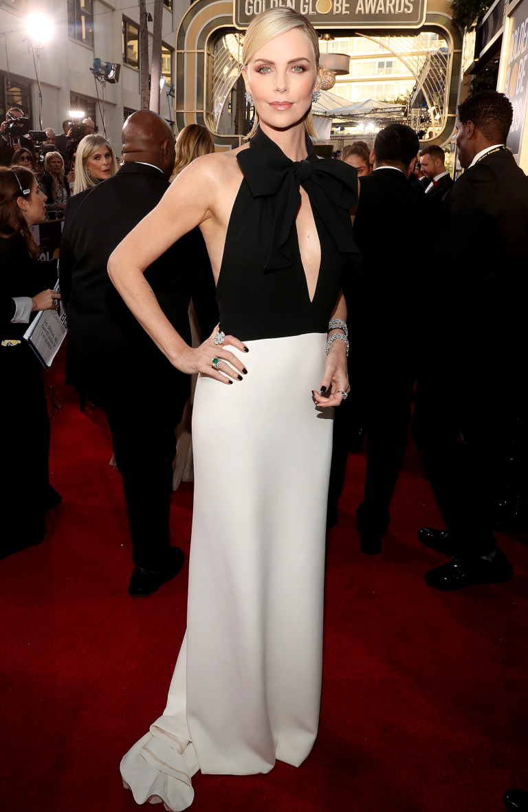 Charlize Theron in Dior Haute Couture and Bulgari jewelry.