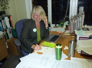 Adriane Carr works the phones at the Green Party head office in Gastown