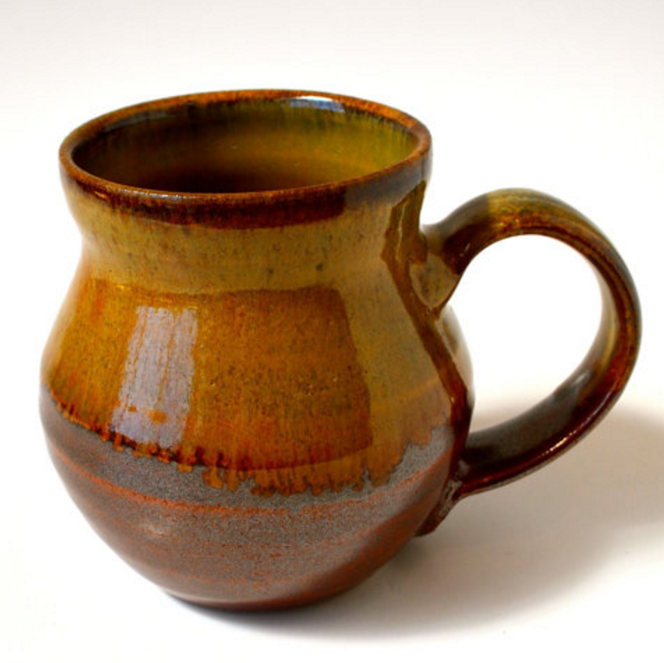 Sample of a handmade mug by artist Kent Harris available in our shop