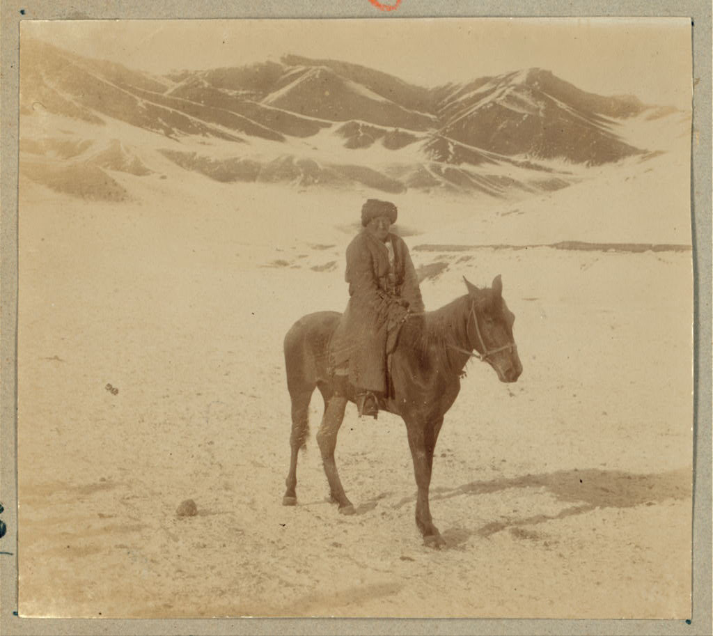 """Bashkir"" Man seated on a horse on the outskirts of Samarkand - ice cold wind off the mountains."