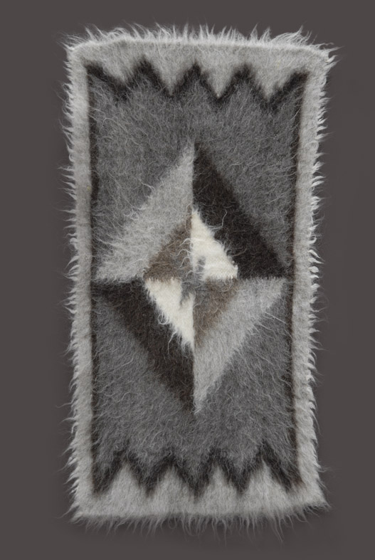 Hairy shaggy primitive animal like Lizhnyk rug