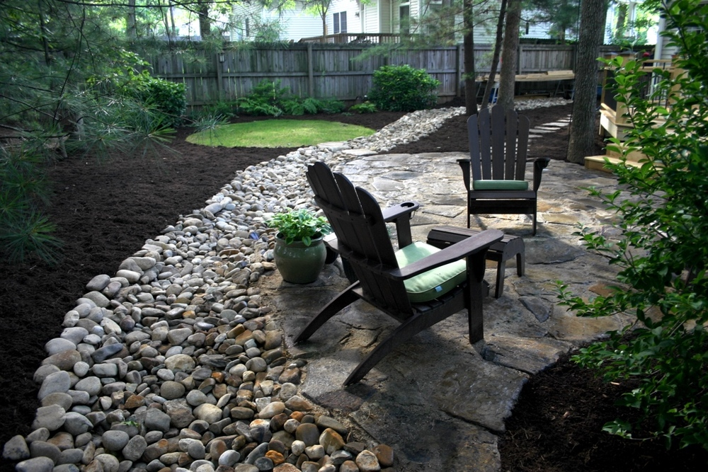 Dry creek bed and stone patio