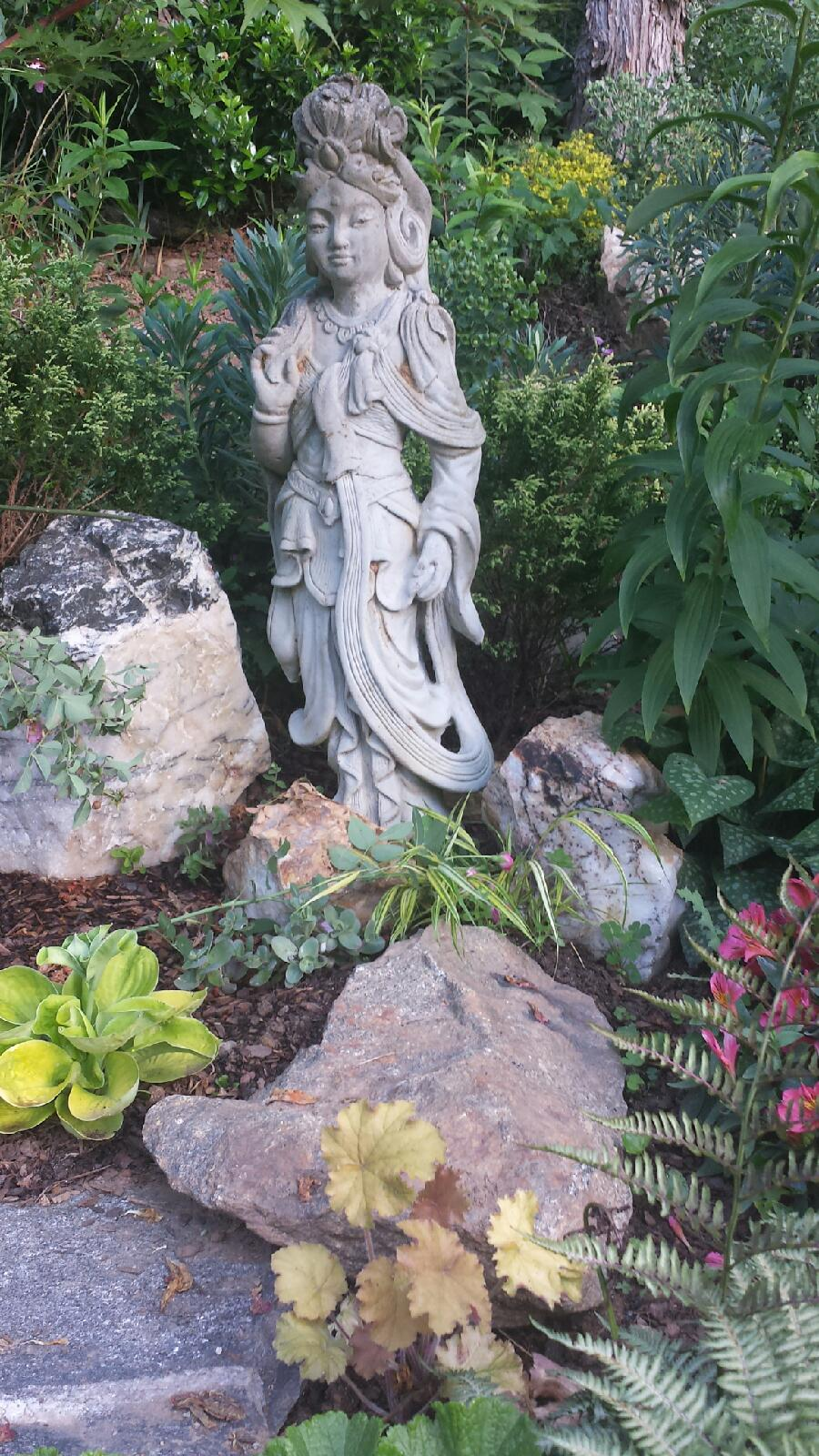 Cynthia added large stones and art work to balance out her love of flowers, and anchor the garden. An easy fix for areas in our gardens that lack structure.