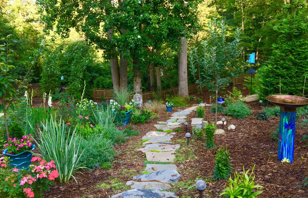"Becky created paths that take her to her ""different gardens."" She's created a total of 8 spaces in the garden, including a secret garden."