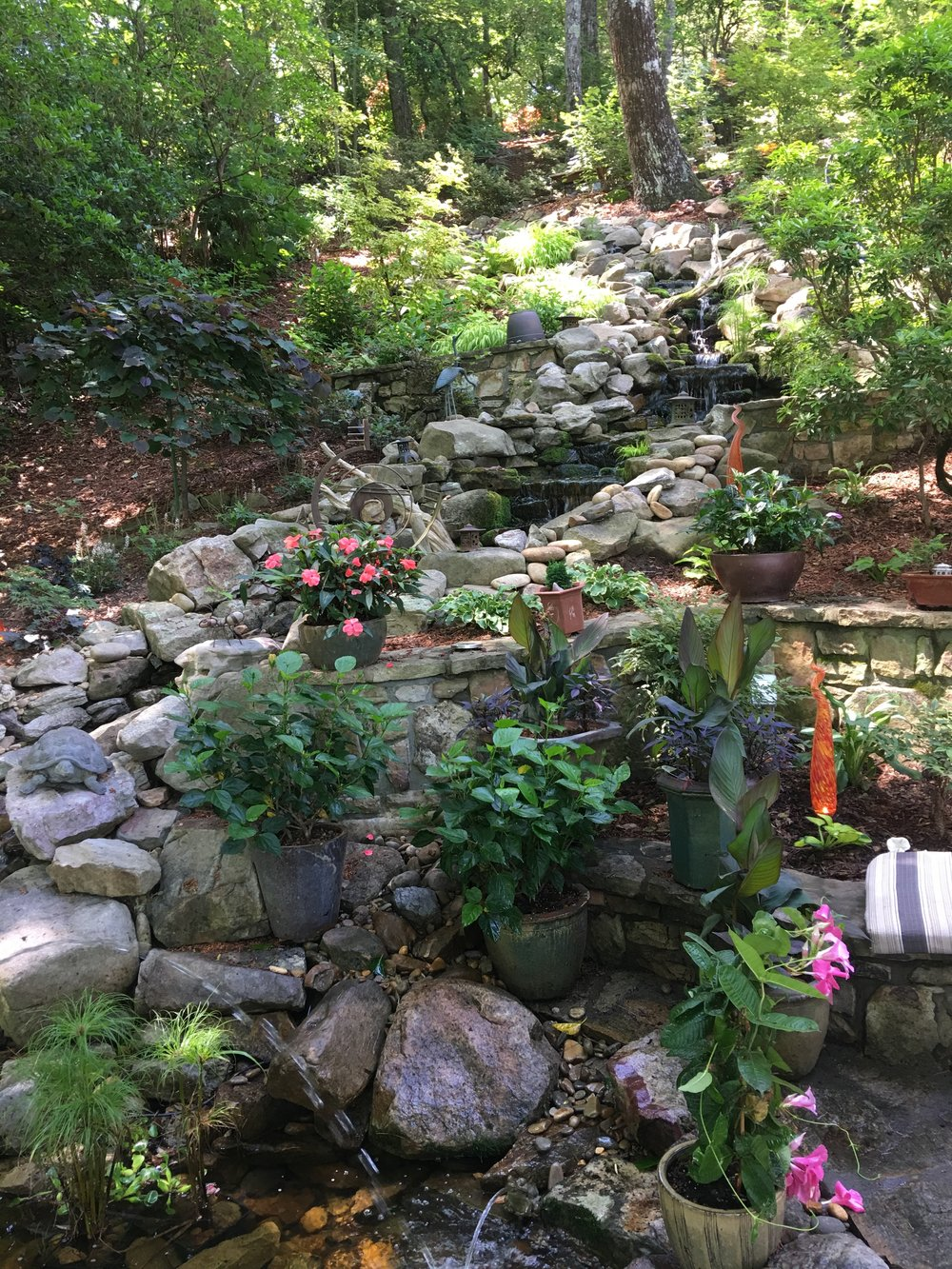 A waterfall feature in a mountain garden.