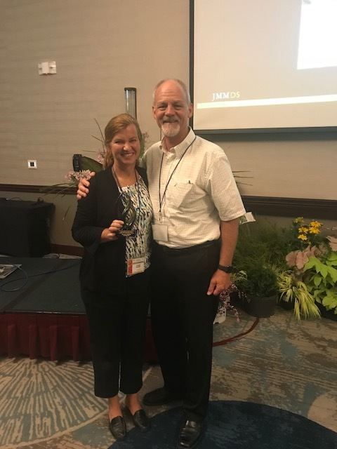 Bryce Lane, Lecturer and Undergraduate Coordinator, North Carolina State University, and member of the North Carolina Nursery and Landscape Association presented the award to Carla Stubbs.