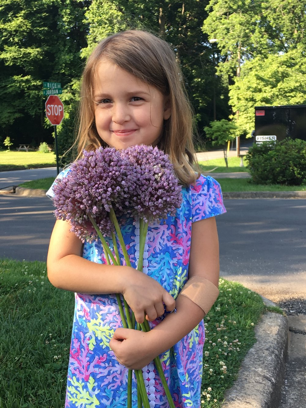 little girl with allium.JPG