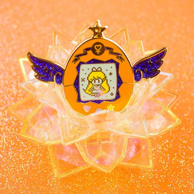 Sharing love from the goddess herself 🧡 It's been awhile since I've posted any of the Sailor Pets! I still remember the incredible response from my first Kickstarter and was so excited to get these out to all the lovely supporters. Since then I've seen these pins paired up with some amazing, custom painted tamagotchis. Still plenty to choose from the rest of the scouts so keep those photos coming! 😊