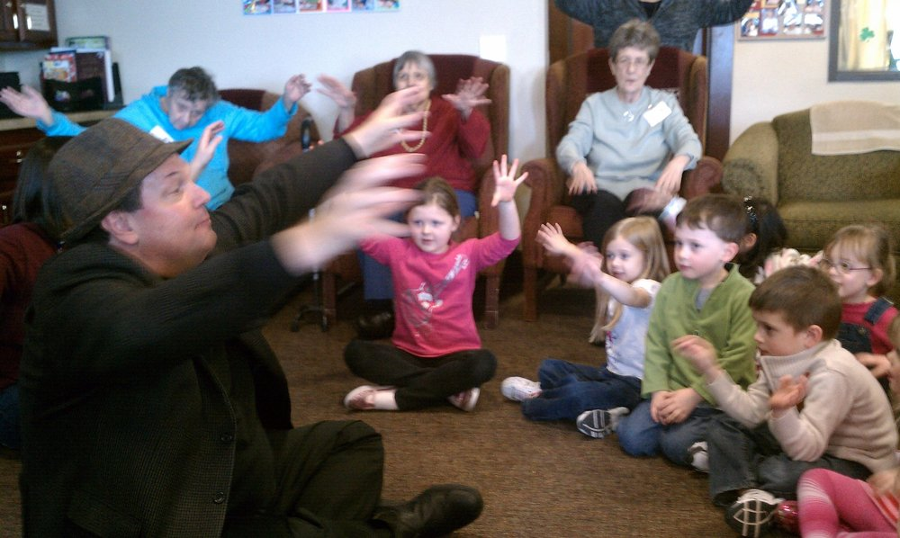 APP founder and Executive Director Gary Glazner with a multigenerational group at Ebenezer Ridges in Burnsville, MN