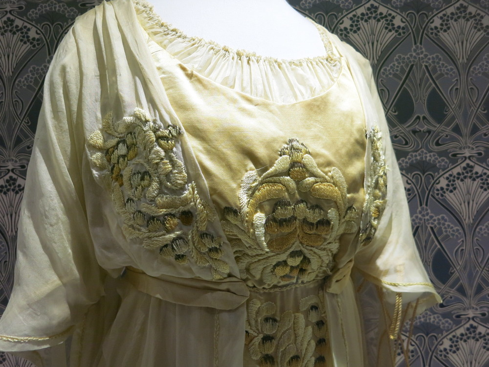 Liberty in Fashion exhibition at the Fashion & Textile Museum, Bermondsey, London 2015. A detail of the embroidery on the 1910 afternoon dress.