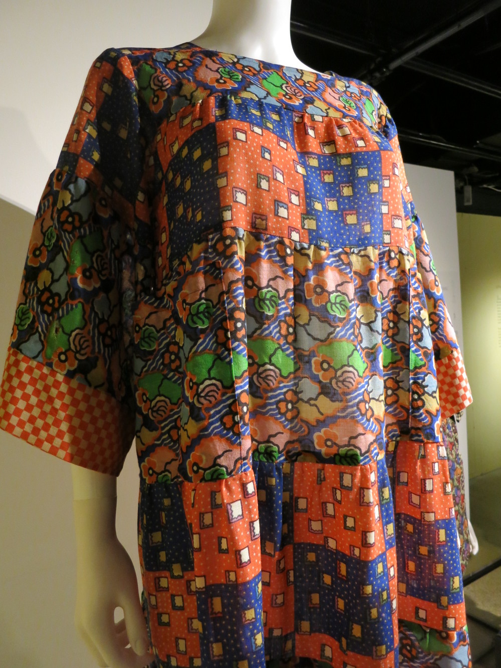 Liberty in Fashion exhibition at the Fashion & Textile Museum, Bermondsey, London 2015. This early 1970s dress was designed by Foale and Tuffin. They loved to mix prints and here they have used prints designed by Richard Nevill, Susan Collier and Sarah Campbell.