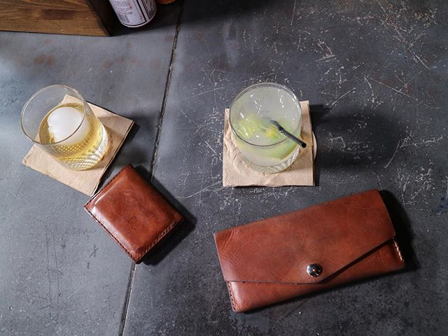 "Father/Daughter wallets (and beverages). My Dad's wallet was one of our very first full-sized wallets to make it out in the world. He was so proud of it and would often show it off to friends and strangers he'd meet. He'd say, ""what do you sell these for? You should be selling these for $300! I'm serious!"" 😆 We gave this wallet to my Dad Christmas 2012 and he carried it every day since. With his memorial service coming up next week, I wanted to do something a little special as a thank-you for his support and encouragement with Deakin, so from now until Saturday, August 26th, the Radley wallet in Hermann Oak Natural Tan is 25% off with use of the code RADLEY25. (Sorry, Dad. Quite the opposite of your $300 suggestion). If you've had your eye on this wallet for a while and have been holding out, now's the time to swoop it up! 🙌🏻"