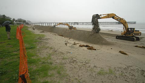 Construction of the sand burm in past years at Goleta Beach