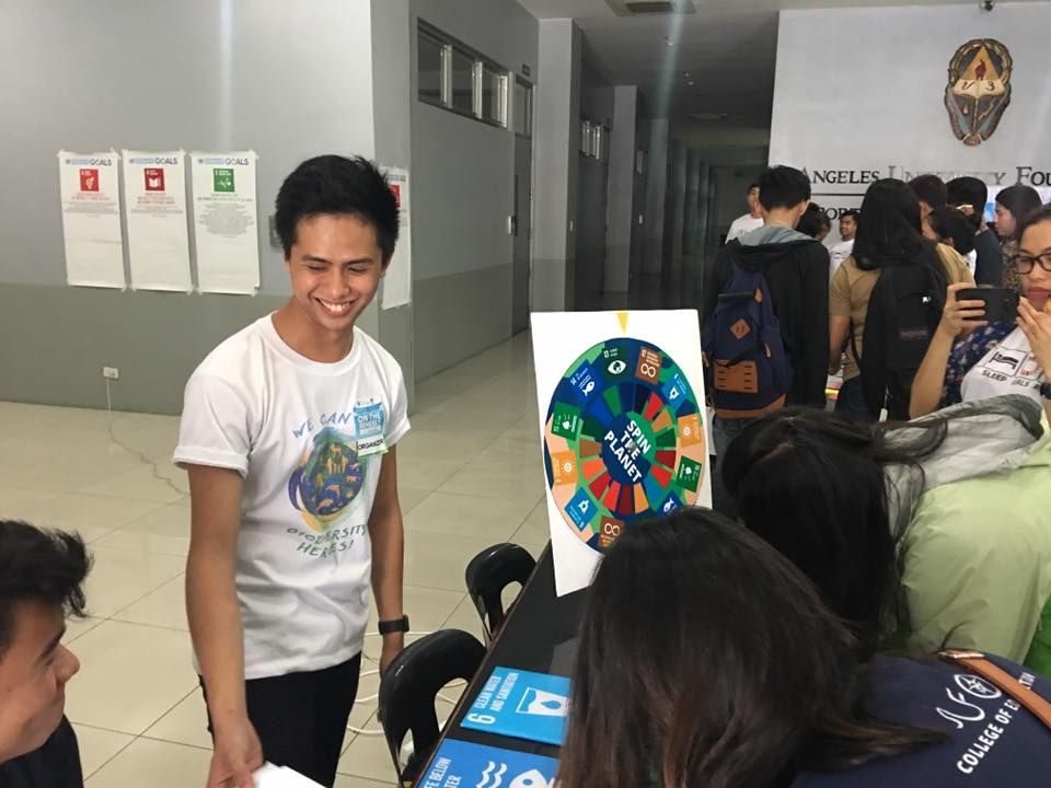 Participants visit different booths at the Global Goals Fair