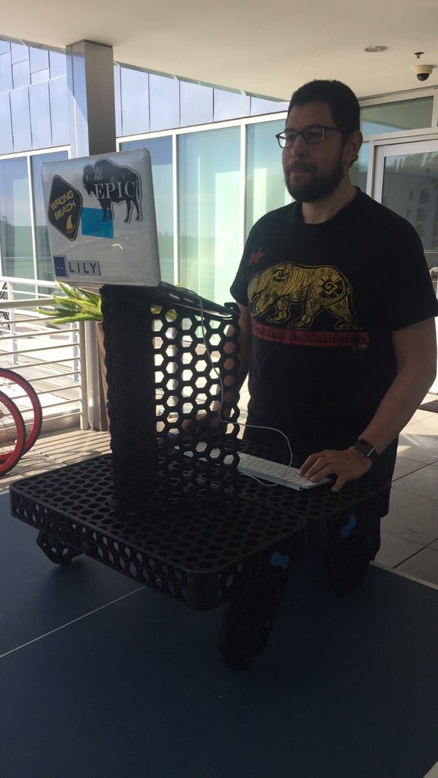 Esteban testing out the OMBEE desk for the first time