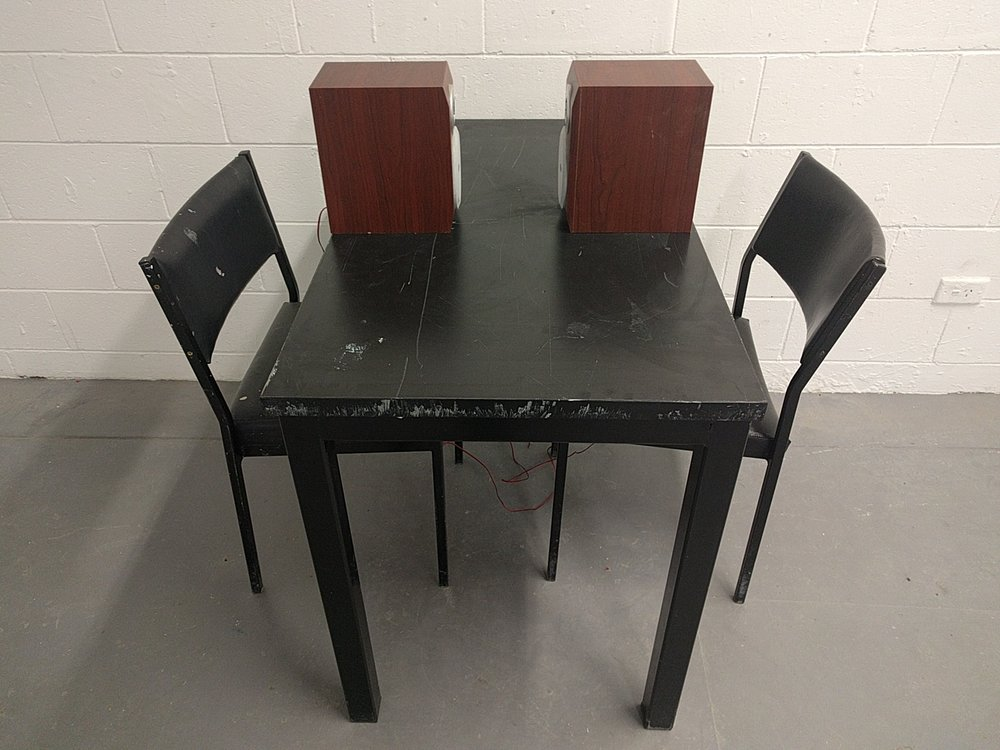 With chairs, on table..