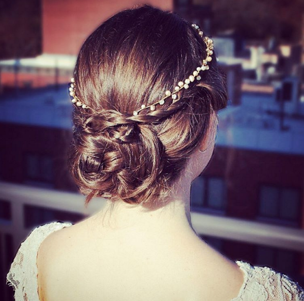 Our Penelope halo, with blush and ivory pearls, tucked perfectly into a braided updo.