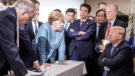 Angela Merkel negotiates with Donald Trump at the G7 summit in Canada, in June 2018.