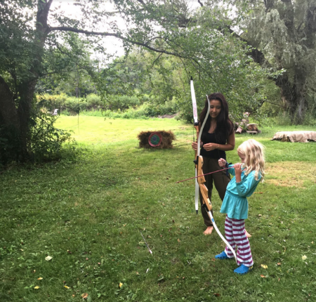 Me helping LDMK practice her archery