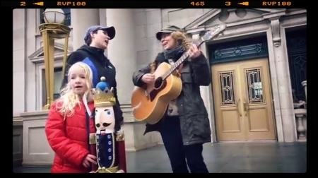 A screenshot from a live video that Maze, her little Guru, and I filmed of us singing for peace on the courthouse steps in Albany, NY.
