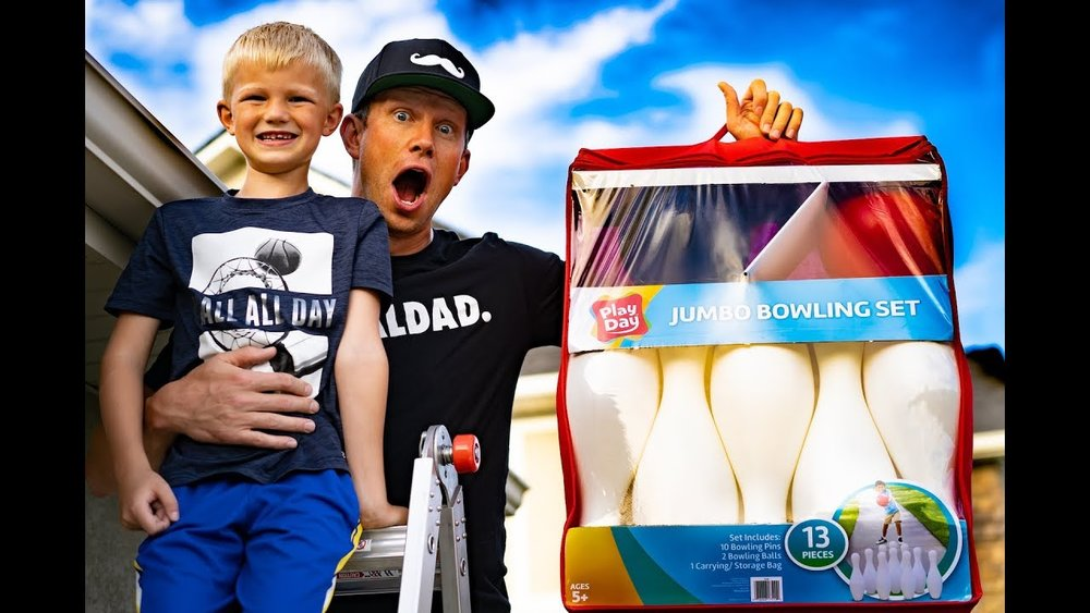 BOWLING TOYS WITH THE DAVIS BOYS (ROOFTOP EDITION) - CLICK HERE TO WATCH IT-KJ bought a huge bowling pin set, and we put him on the roof to increase the level of difficulty:)