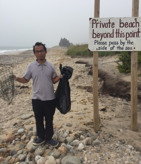 Diky cleaning up the South Kingstown Beach for Save the Bay
