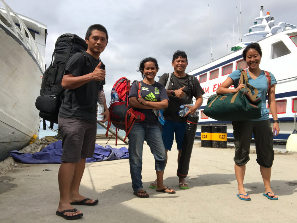 Elle (far right) on her travels to Kasuari village. It took three days of travel by air, land, and sea!