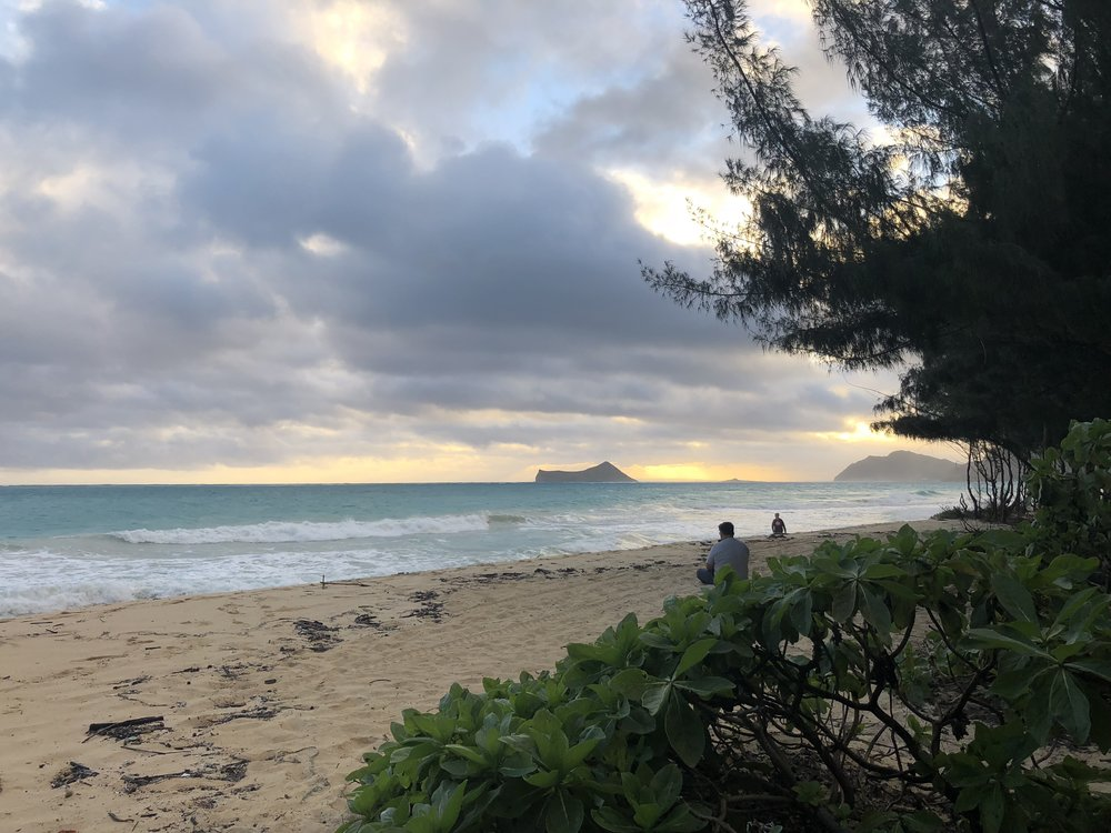 One of Kelvin's last weekends in Hawaii, watching the sunrise on Waimanalo Beach, one of his favorite places on the island of Oahu