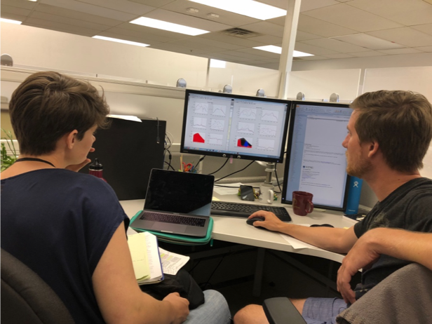 Dr. Romain Lavaud shows Celeste how his sea lettuce model runs in MATLAB.  Photo credit: Austin Humphries