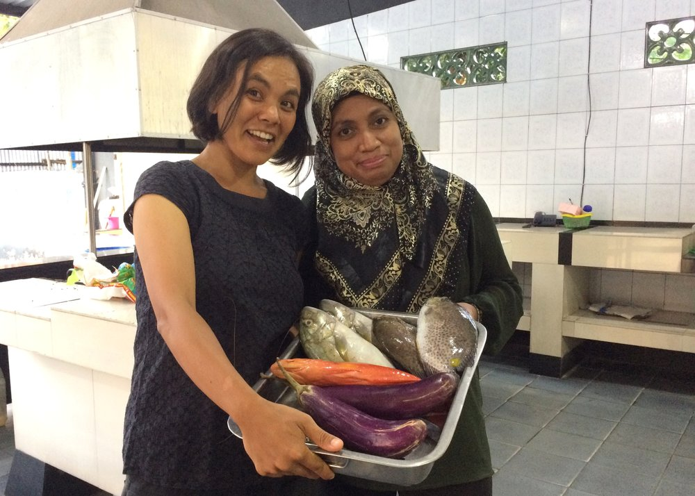 Melati and research collaborator Professor Wa Iba of Universitas Halu Oleo celebrate one year of successful data collection with a fish fry.