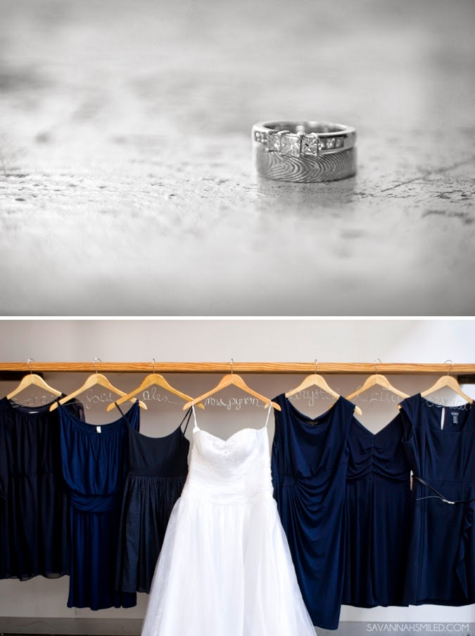 different-navy-bridesmaid-dresses-with-name-hangers-photo.jpg