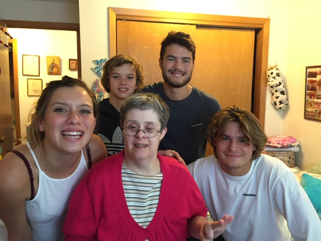 From left to right: Lilia Mora, Trey Mora, Cole Mora, and Ryder Mora with their aunt, Whittney, center.