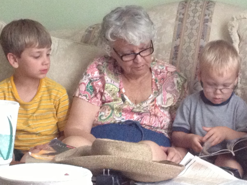 Watching my mom read to my nephews Harry and Trevor. Precious.