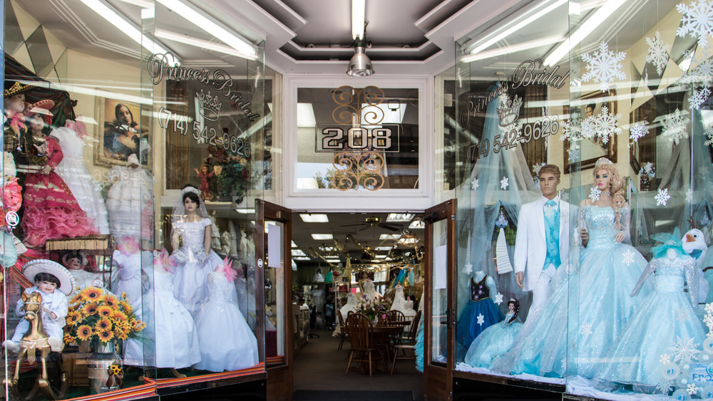 The window display of Princess Bridal, a shop that sells quinceñera and wedding dresses, favors, decorations, and more for over ten years in downtown Santa Ana.