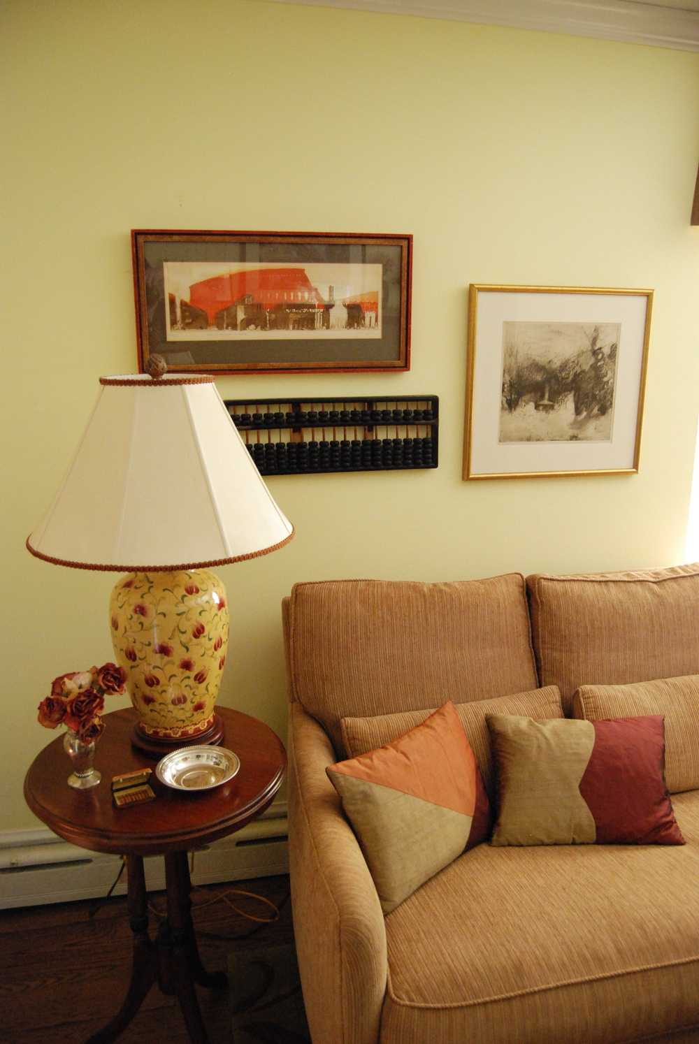 These custom pillows provide a rich complement to the variety of pieces on the wall, intensifying their impact.