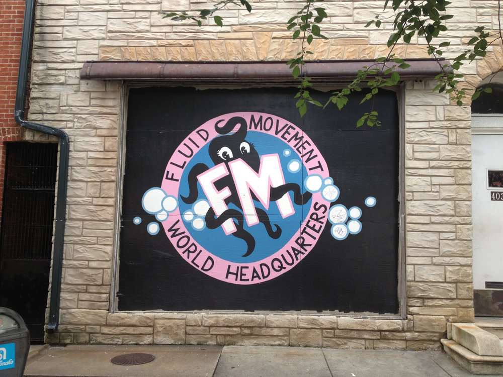 Logo mural at Fluid Movement HQ in Baltimore, MD.