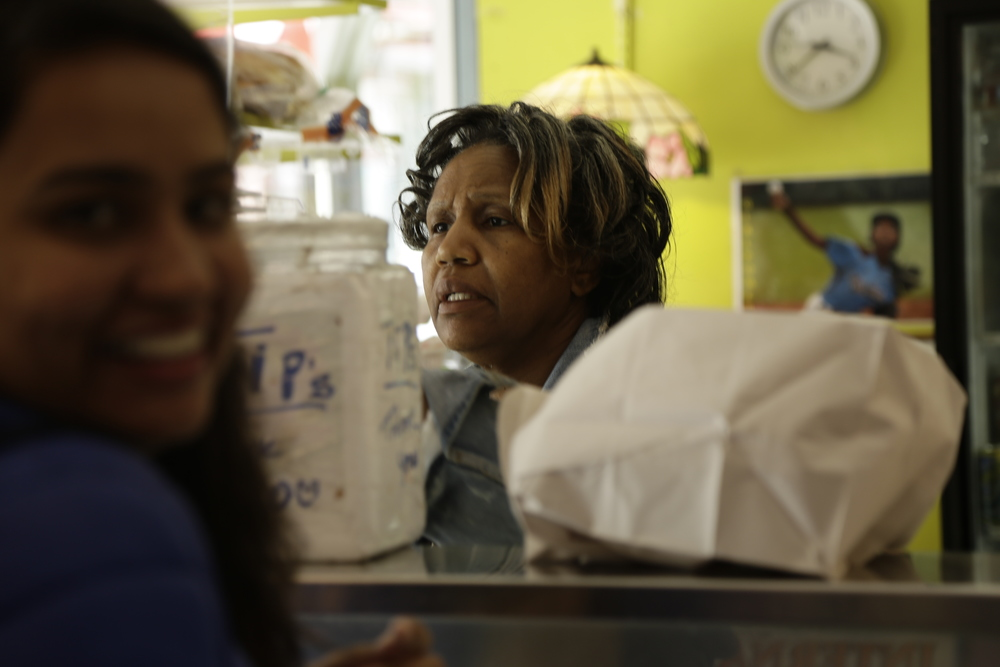 Teresa bennett serves up sandwiches from behind the counter at miyako ice cream shop.