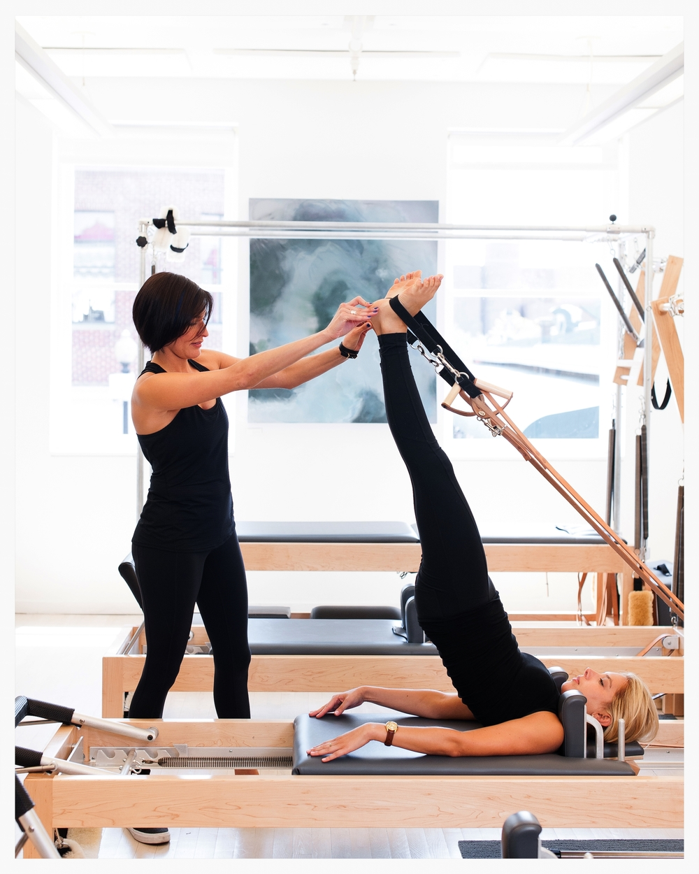 long spine on reformer pilates apparatus private